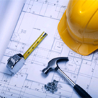 Hard hat and blueprint picture.  Click for construction related insurance.